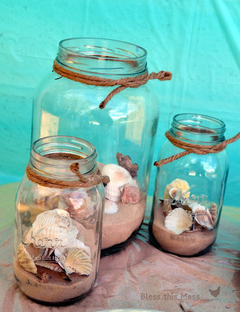 Beach birthday party decorations and food tables mason jars